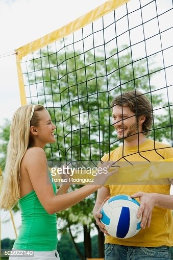 Couple Playing Beach Volleyball : ストックフォト
