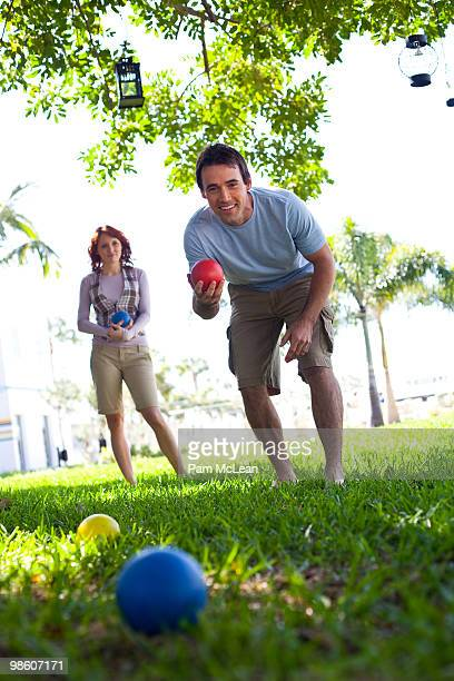 Couple playing bocce ball