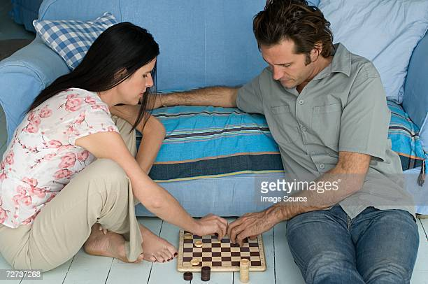 Couple playing checkers