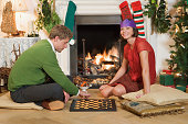 Couple playing chess at Christmas