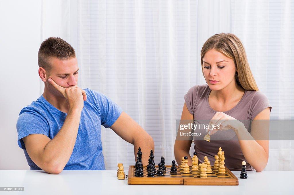 Couple playing chess : Stock Photo