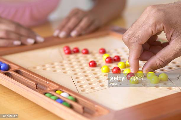 Couple Playing Chinese Checkers