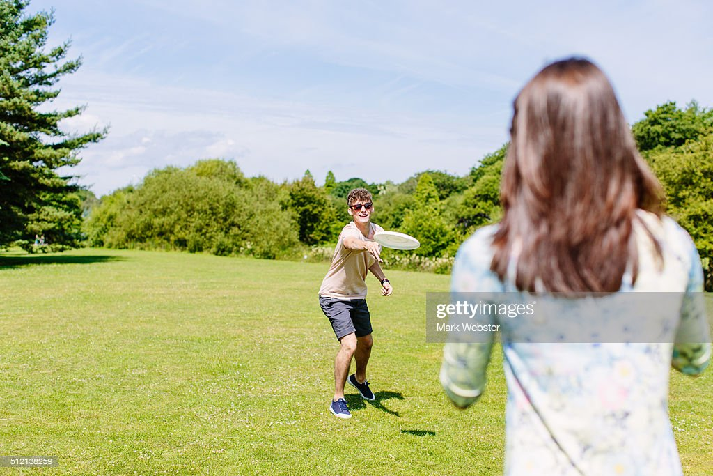 Couple playing disc game in the park