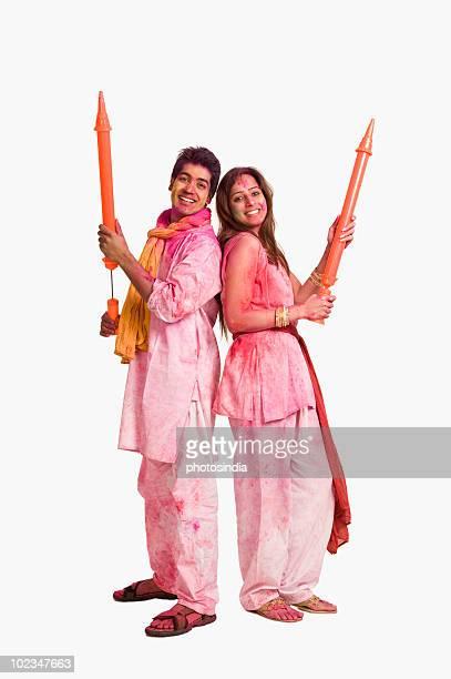 Couple playing Holi with pichkaris