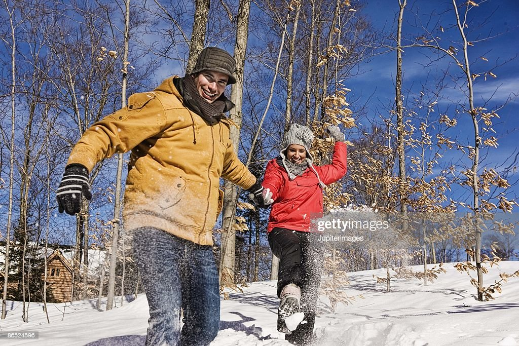 Couple playing in snow : Stock Photo