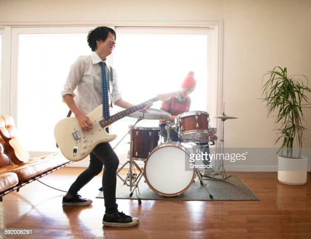 Couple playing music in living room