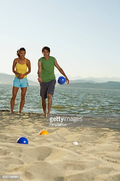 Couple playing on a beach