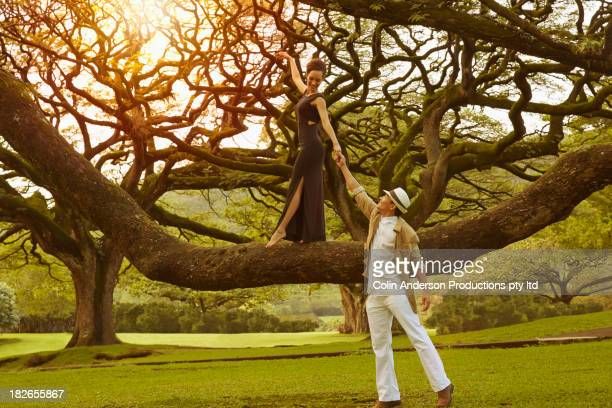 Couple playing on banyan tree