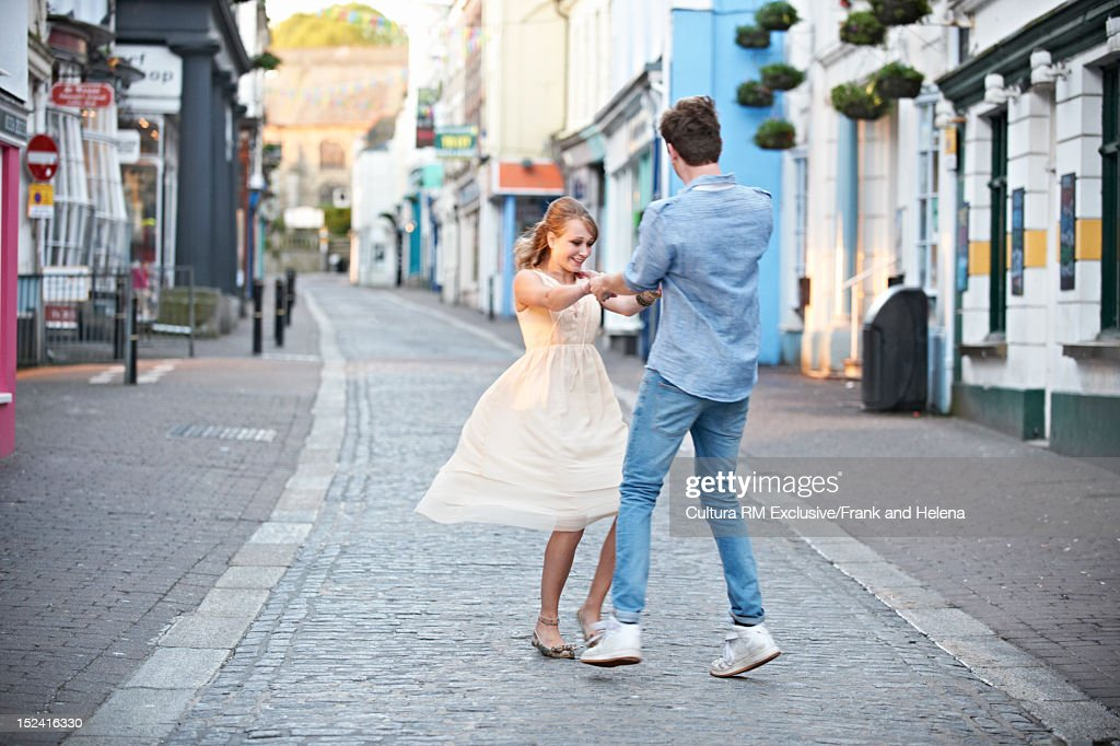 Couple playing on city street : Stock Photo