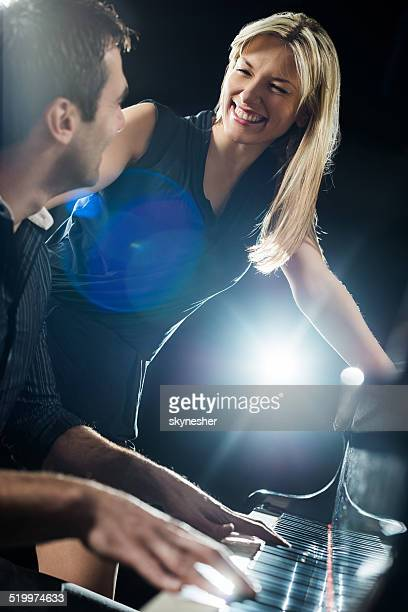 Couple playing piano.