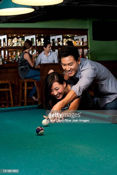 Couple Playing Pool Together