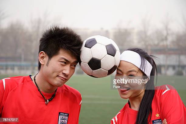 Couple Playing Soccer
