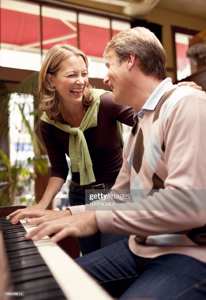 couple playing the piano : Stock Photo