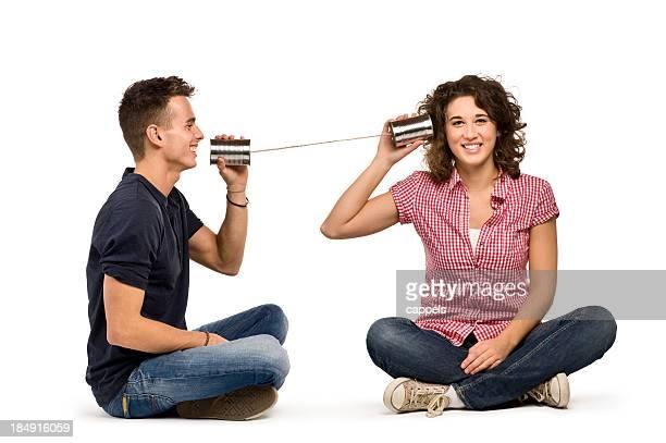 Paar spielt mit einer Dose kann Phone.Color Bild