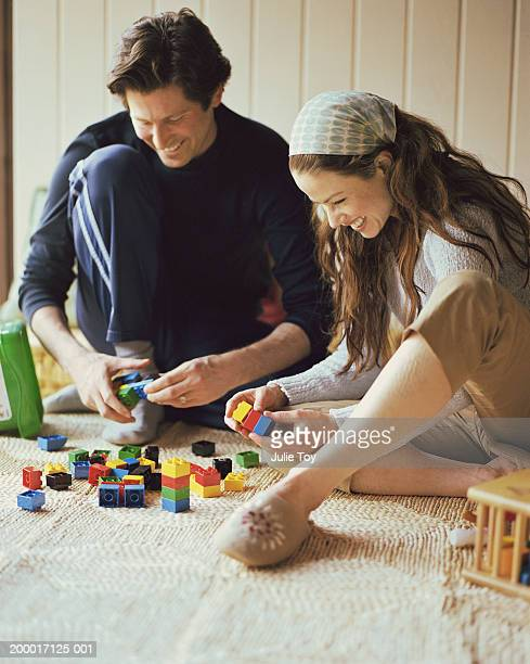 Couple playing with connecting blocks