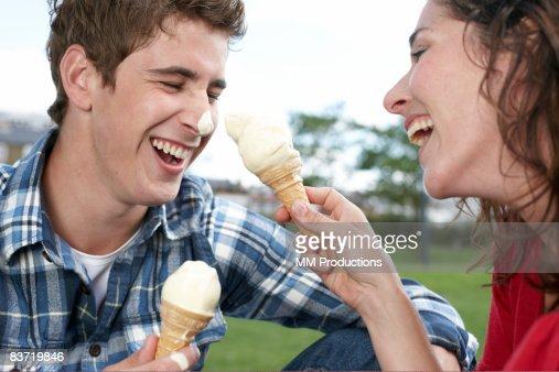 Couple playing with ice cream cones : Stock Photo