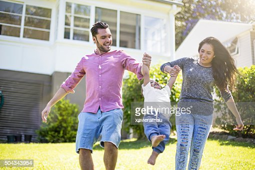 Couple playing with their son in garden