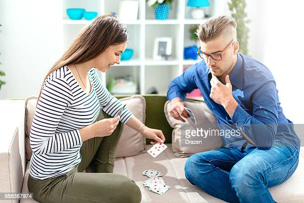 Couple plying cards in living room