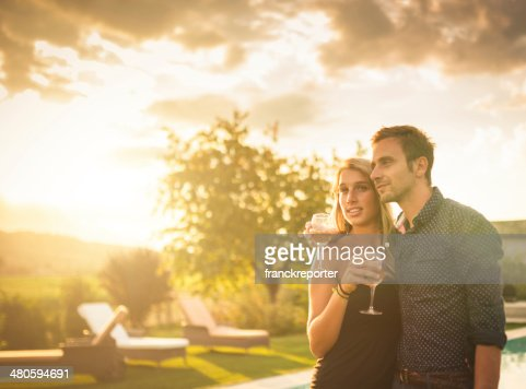 couple portrait looking forward at sunset : Stock Photo