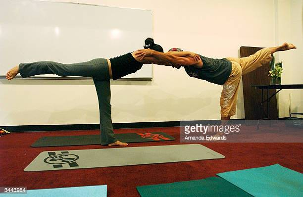 A couple pose during Step Up Women's Network's Third Annual 'Step Up For Yoga and Health' charity festival at Bergamont Station April 18 2004 in...