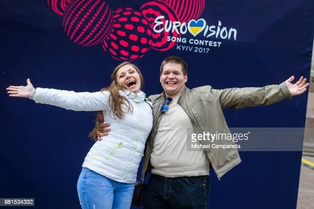 A couple pose for a picture in front of the Eurovision logo at the Eurovision Village on May 10 2017 on Kreschatyk Street in Kiev Ukraine The final...