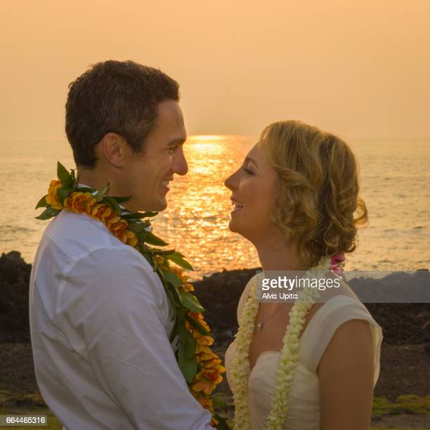 Couple pose for photos after Hawaii wedding.
