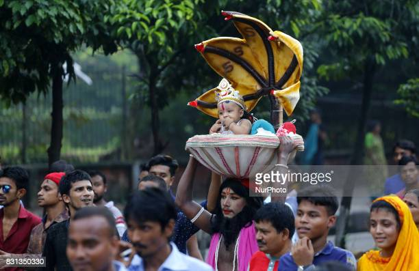 A couple poses as Sri Krishna and Radha on a peacock like float in a procession marking Janmashtami in Dhaka Bangladesh on 14 August 2017 The Hindu...