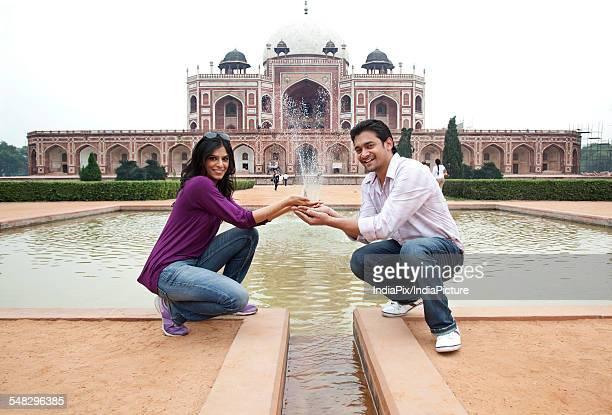 Couple posing at Humayuns Tomb