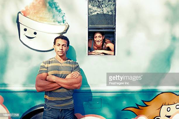Couple posing by ice cream truck