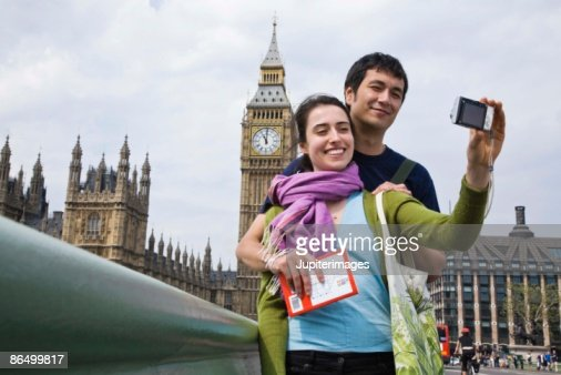 Couple posing for self portrait by Big Ben, London, England : Stock Photo