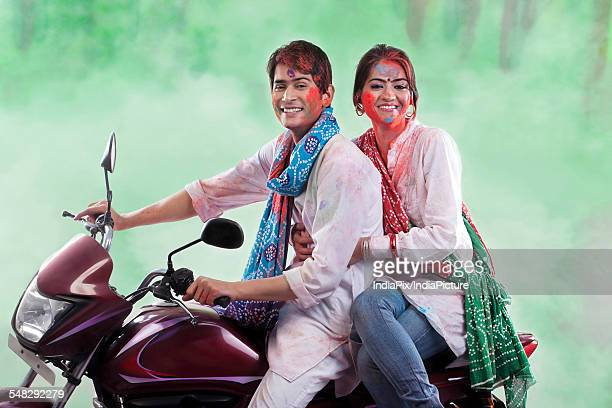 Couple posing on a motorcycle
