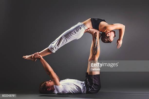 Couple practicing acro yoga
