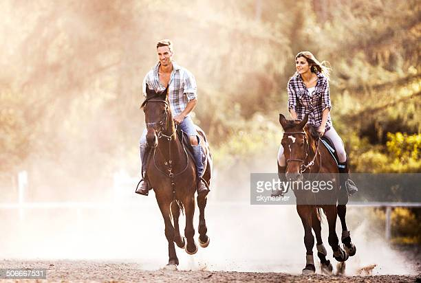 Couple practicing with their horses.