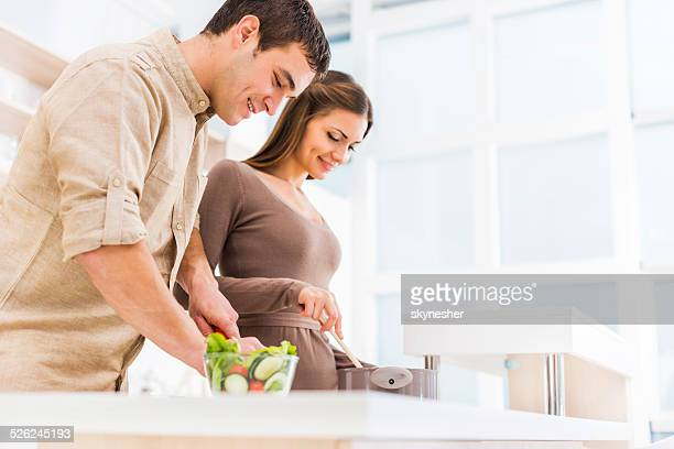 Couple preparing lunch together.