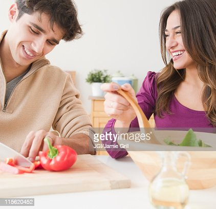Couple preparing salad together : Stock Photo