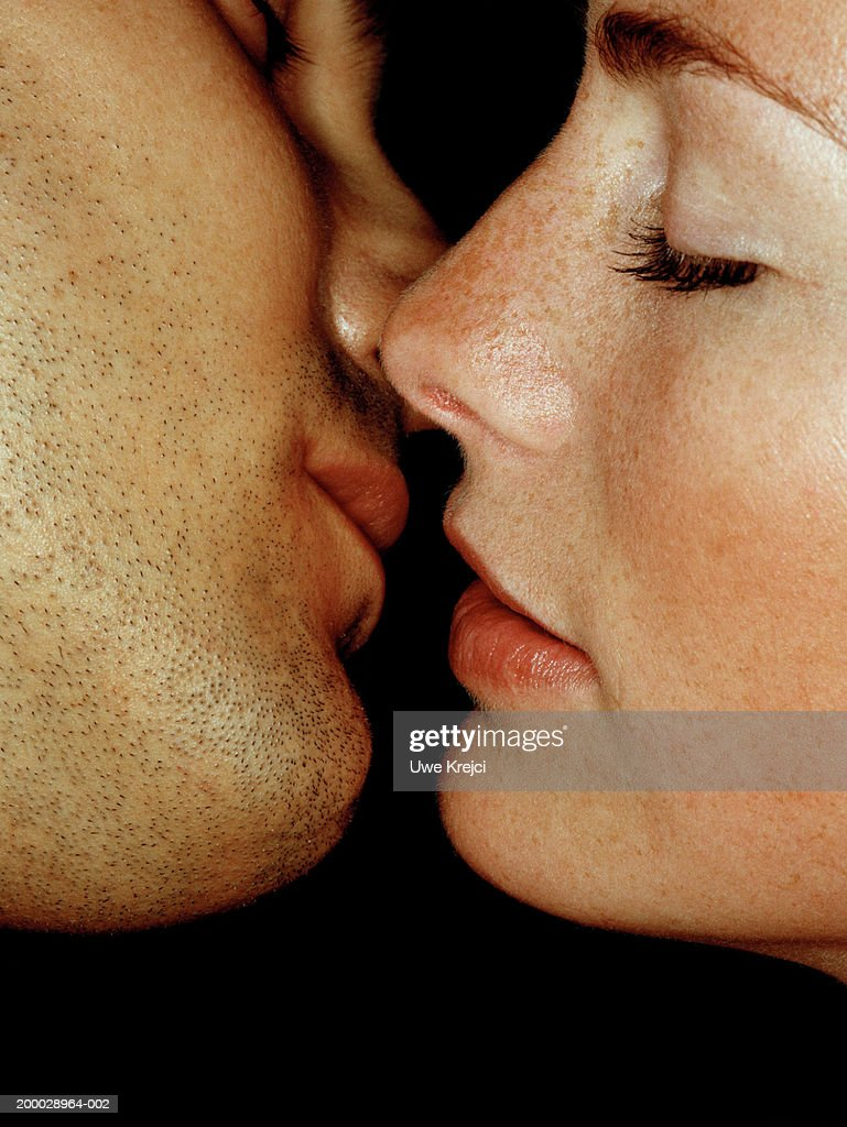 Couple preparing to kiss, close-up