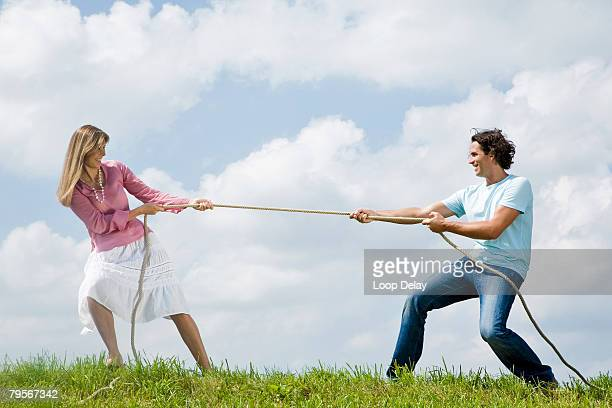 'Couple pulling rope, close-up'