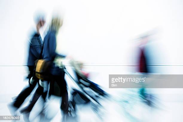 Couple Pushing Baby in Stroller, Motion Blur