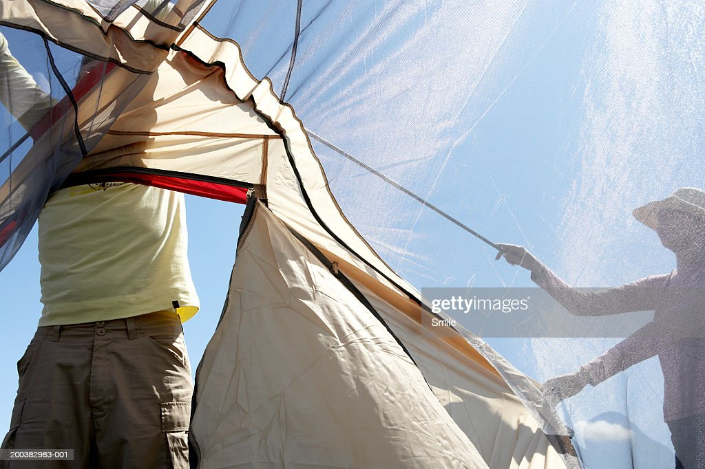 Couple putting up tent : Stock Photo