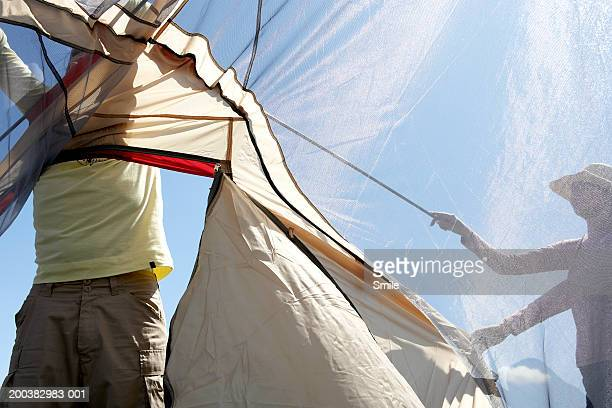 Couple putting up tent