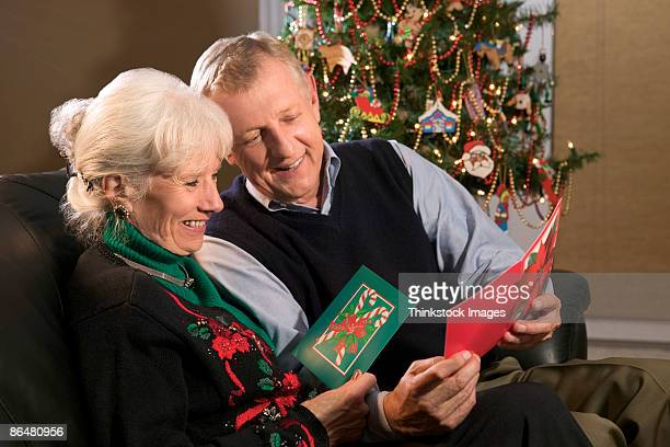 Couple reading Christmas cards