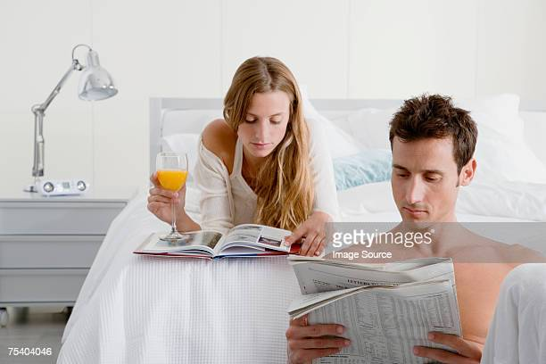 Couple reading in bedroom