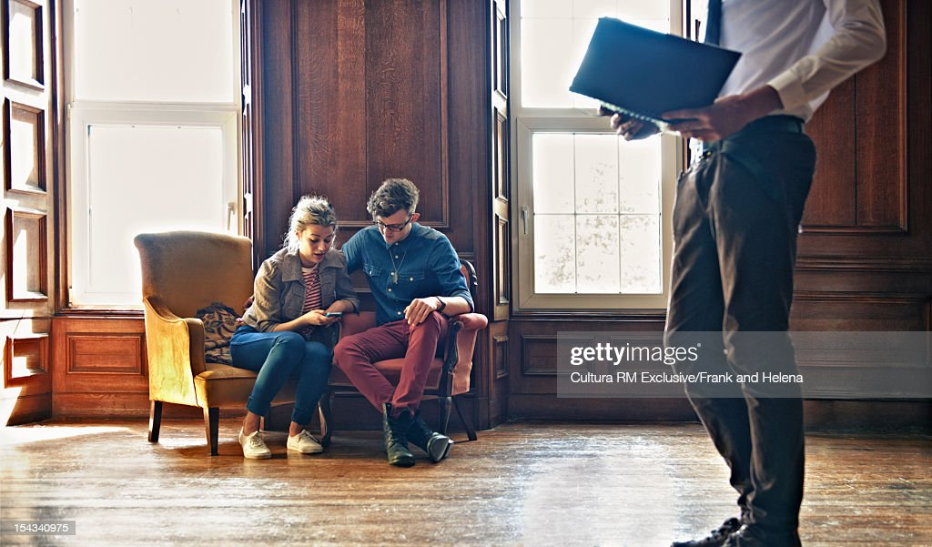 Couple reading in ornate study : Stock Photo