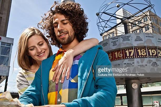 Couple reading map at Alexanderplatz