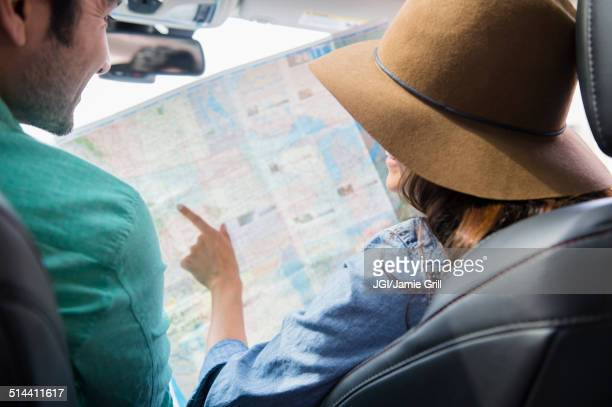 Couple reading map together