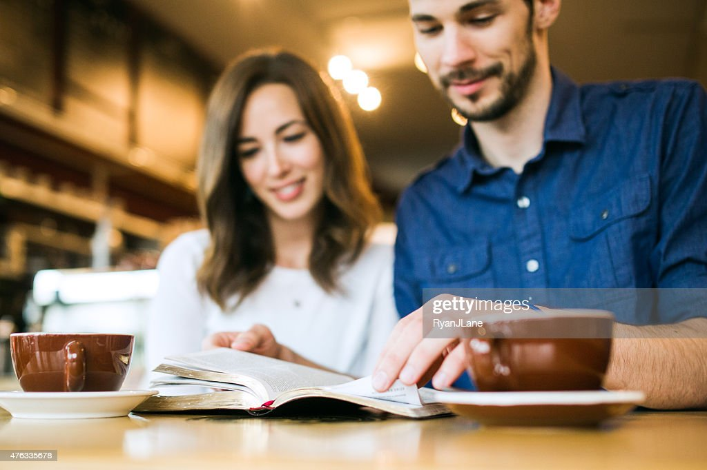 Couple Reading The Bible Together : Stock Photo