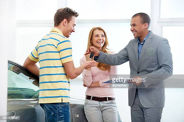 Couple receiving a new car keys