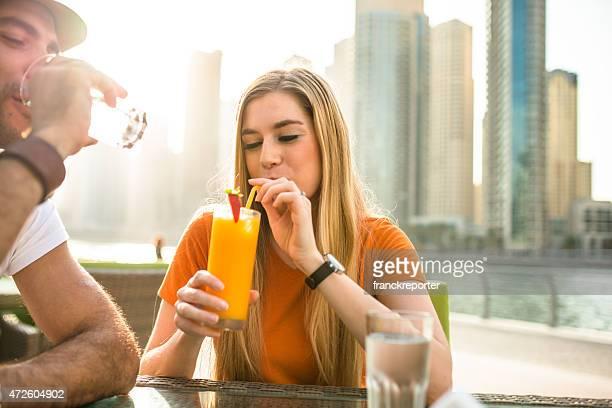 couple refreshment at cafe in dubai marina
