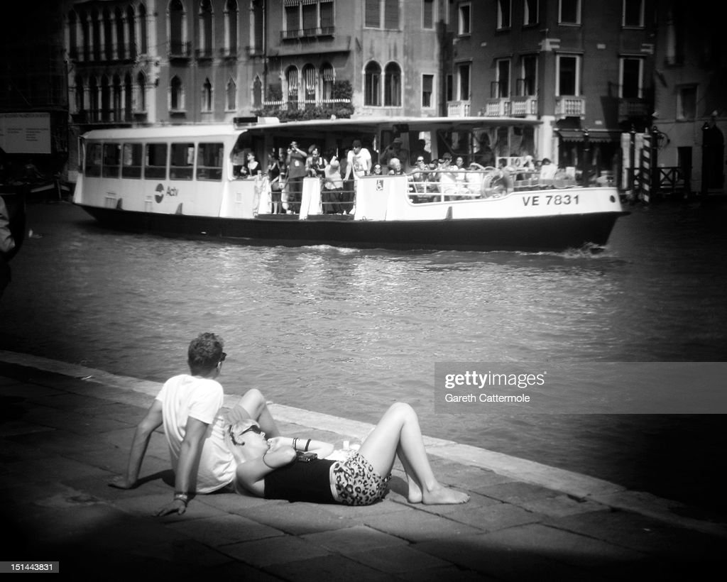 A couple relax by the Grand Canal in Venice during the 69th Venice Film Festival on September 7, 2012 in Venice, Italy.