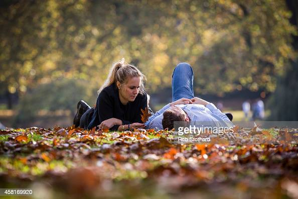 A couple relax in the sunshine in St James Park on October 31 2014 in London England Temperatures in London are forecasted to exceed 20 degrees...